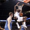 Oklahoma City\'s Kyle Weaver dunks the ball between Washington\'s Darius Songaila, left, and Antawn Jamison during the NBA basketball game between the Oklahoma City Thunder and the Washington Wizards at the Ford Center in Oklahoma City, Wed., March 4, 2009. PHOTO BY BRYAN TERRY, THE OKLAHOMAN