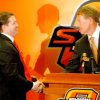 New Oklahoma State University college basketball head coach Travis Ford, left, shakes hands with athletic director Mike Holder during Ford\'s introductory press conference at Gallagher-Iba Arena in Stillwater, Okla., Thursday, April 17, 2008. BY MATT STRASEN, THE OKLAHOMAN