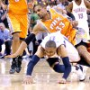 Oklahoma City\'s Russell Westbrook (0) and Phoenix\'s Grant Hill (3) scramble fof a loose ball during the NBA game between the Oklahoma City Thunder and the Phoenix Suns, Sunday, March 6, 2011, the Oklahoma City Arena. Photo by Sarah Phipps, The Oklahoman.
