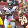 Atlanta Falcons running back Jacquizz Rodgers pushes Washington Redskins cornerback Richard Crawford away during the first half of an NFL football game in Landover, Md., Sunday, Oct. 7, 2012. (AP Photo/Richard Lipski)