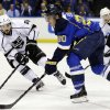 Photo - St. Louis Blues' Alexander Steen (20) passes the puck as Los Angeles Kings' Drew Doughty, left, and Trevor Lewis, right, defend during the second period of an NHL hockey game, Monday, Feb. 11, 2013, in St. Louis. (AP Photo/Jeff Roberson)