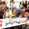 Cheyenne Middle School students and faculty sign the Rachel's Challenge banner. Photo by Jim Beckel, The Oklahoman