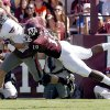 Oklahoma State\'s Brandon Weeden is sacked by Texas A&M\'s Sean Porter in the first half Saturday in College Station, Texas. Photo by Sarah Phipps, The Oklahoman