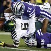 Oregon running back De\'Anthony Thomas (6) scores a touchdown as Kansas State defensive back Randall Evans (15 ) and Arthur Brown (4) defend during the first half of the Fiesta Bowl NCAA college football game, Thursday, Jan. 3, 2013, in Glendale, Ariz. (AP Photo/Ross D. Franklin)