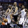 San Antonio Spurs\' Tony Parker, center, is fouled as he drives past Charlotte Bobcats\' Al Jefferson, left, and Michael Kidd-Gilchrist, right, during the first half of an NBA basketball game in Charlotte, N.C., Saturday, Feb. 8, 2014. (AP Photo/Chuck Burton)