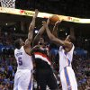 Oklahoma City Thunder\'s Kendrick Perkins (5) and Serge Ibaka (9) defend against Portland Trail Blazers\' J.J. Hickson (21) as the Oklahoma City Thunder defeat the Portland Trail Blazers 106-92 in NBA basketball at the Chesapeake Energy Arena in Oklahoma City, on Friday, Nov. 2, 2012. Photo by Steve Sisney, The Oklahoman
