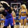 The Thunder Girls dance team performs with visiting mascots during an NBA basketball game between the Memphis Grizzlies and the Oklahoma City Thunder at Chesapeake Energy Arena in Oklahoma City, Friday, Feb. 28, 2014. Photo by Nate Billings, The Oklahoman