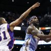 Denver Nuggets\' Ty Lawson (3) looks to shoot under pressure from Phoenix Suns\' Sebastian Telfair (31) in the first half during an NBA basketball game on Monday, Nov. 12, 2012, in Phoenix. (AP Photo/Ross D. Franklin)