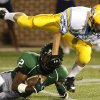 Putnam City West\'s Anthony Paolo soars over Edmond Santa Fe\'s Matt Jackson during the high school football game between Edmond Santa Fe and Putnam City West at Wantland Stadium in Edmond, Okla. on Friday, Oct. 5, 2007. By James Plumlee, The Oklahoman.