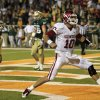 Oklahoma quarterback Blake Bell (10) celebrates after scoring a touchdown that helped tie the game against Baylor late in the second half of an NCAA college football game, Saturday, Nov. 19, 2011, in Waco, Texas. No. 25 Baylor defeated No. 5 Oklahoma 45-38. (AP Photo/Tony Gutierrez) ORG XMIT: TXTG220