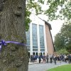 A purple ribbon in support of stopping domestic violence is displayed on a tree in front of St. John the Evangelist Church at the funeral service for Alexandra Kogut, Monday, Oct. 4, 2012, in New Hartford, N.Y.Kogut\'s body was found early Saturday in her dorm room at the State University of New York College at Brockport, near Rochester. Her boyfriend Clayton Whittemore, of New Hartford, is charged with the killing. (AP Photo/Observer-Dispatch, Mark DiOrio)