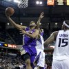 Phoenix Suns guard Jared Dudley, left, drives to the basket between Sacramento Kings\' Marcus Thornton, center, and DeMarcus Cousins during the first quarter of an NBA basketball game in Sacramento, Calif., Wednesday, Jan. 23, 2013. (AP Photo/Rich Pedroncelli)