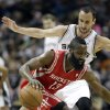 Houston Rockets\' James Harden (13) tries ot move the ball around San Antonio Spurs\' Manu Ginobili, right, of Argentina, during the first quarter of an NBA basketball game on Friday, Dec. 28, 2012, in San Antonio. (AP Photo/Eric Gay)