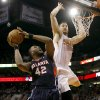 Photo - Atlanta Hawks' Elton Brand (42) shoots over Phoenix Suns' Miles Plumlee during the first half of an NBA basketball game, Sunday, March 2, 2014, in Phoenix. (AP Photo/Matt York)