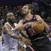 Photo - Charlotte Bobcats' Al Jefferson, left, strips the ball from Chicago Bulls' Joakim Noah during the second half of an NBA basketball game in Charlotte, N.C., Wednesday, April 16, 2014. The Bobcats won 91-86 in overtime. (AP Photo/Chuck Burton)