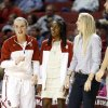 Oklahoma Sooner\'s Aaryn Ellenberg, center, wears street clothes on the bench as the University of Oklahoma Sooners (OU) defeat the Kansas Jayhawks 64-61 in NCAA, women\'s college basketball at The Lloyd Noble Center on Saturday, Feb. 22, 2014 in Norman, Okla. Photo by Steve Sisney, The Oklahoman