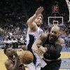 Chicago Bulls\' Jimmy Butler (21) and Carlos Boozer, right, battle for a rebound against Orlando Magic\'s Josh McRoberts, center, during the first half of an NBA basketball game, Wednesday, Jan. 2, 2013, in Orlando, Fla. (AP Photo/John Raoux)
