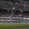Photo - The field takes the green flag to start the NASCAR Truck Series auto race at Daytona International Speedway in Daytona Beach, Fla., Friday, Feb. 21, 2014. (AP Photo/Terry Renna)