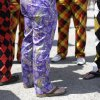 Spectators wear colorful pants before the 140th running of the Kentucky Derby horse race at Churchill Downs Saturday, May 3, 2014, in Louisville, Ky. (AP Photo/David Goldman)