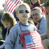 Seven year old Nicholas Martin watches a Veterans Day parade on SE 15th St. in Midwest City, OK, Monday, November 11, 2013, Photo by Paul Hellstern, The Oklahoman