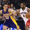 Los Angeles Lakers guard Steve Nash, left, applies pressure on Toronto Raptors forward Alan Anderson, right, during first half NBA basketball action in Toronto on Sunday Jan. 20, 2013. (AP Photo/THE CANADIAN PRESS,Nathan Denette)