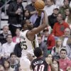 Utah Jazz center Al Jefferson (25) shoots as Miami Heat forward Udonis Haslem (40) looks on in the first quarter during an NBA basketball game Monday, Jan. 14, 2013, in Salt Lake City. (AP Photo/Rick Bowmer)