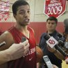 Photo - University of Oklahoma (OU) Sooner men's basketball player Carl Blair Jr., talks to the media after the team