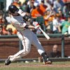Photo - San Francisco Giants' Buster Posey hits a double against the Arizona Diamondbacks during the fourth inning of a baseball game, Sunday, Sept. 8, 2013, in San Francisco.  (AP Photo/George Nikitin)