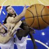Philadelphia 76ers\' Spencer Hawes, left, and Jason Richardson, right, battle with Toronto Raptors\' Jonas Valanciunas, of Lithuania, for a rebound in the first half of an NBA basketball game, Tuesday, Nov. 20, 2012, in Philadelphia. (AP Photo/Matt Slocum)