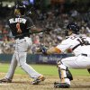 Photo - Miami Marlins' Jordany Valdespin (1) hits a home run, also scoring Adeiny Hechavarria, during the ninth inning of a baseball game against the Houston Astros, Saturday, July 26, 2014, in Houston. (AP Photo/Patric Schneider)