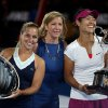 Photo - Former World No.1 and two time Australian Open champion, Chris Evert, center, pose with winner Li Na of China, right, and rummer-up Dominika Cibulkova of Slovakia during the trophy presentation of their women's singles final at the Australian Open tennis championship in Melbourne, Australia, Saturday, Jan. 25, 2014. (AP Photo/Rick Rycroft)