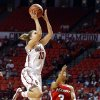 Oklahoma\'s Morgan Hook (10) shoots in front of Marist\'s Natalie Gomez (3) during the women\'s college basketball game between the University of Oklahoma and Marist at Lloyd Noble Center in Norman, Okla., Sunday,Dec. 2, 2012. Photo by Sarah Phipps, The Oklahoman