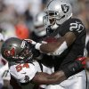 Oakland Raiders running back Darren McFadden (20) is tackled by Tampa Bay Buccaneers outside linebacker Lavonte David (54) during the second quarter of an NFL football game in Oakland, Calif., Sunday, Nov. 4, 2012. McFadden left the game with a leg injury. The Raiders said he was questionable to return. (AP Photo/Marcio Jose Sanchez)