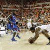 Oklahoma State \'s Marcus Smart (33) slips as he starts to drive on Kansas\' Elijah Johnson (15) during the college basketball game between the Oklahoma State University Cowboys (OSU) and the University of Kanas Jayhawks (KU) at Gallagher-Iba Arena on Wednesday, Feb. 20, 2013, in Stillwater, Okla. Photo by Chris Landsberger, The Oklahoman