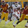 Oklahoma\'s Brennan Clay (24) runs pas Iowa State\'s David Irving (87) during a college football game between the University of Oklahoma (OU) and Iowa State University (ISU) at Jack Trice Stadium in Ames, Iowa, Saturday, Nov. 3, 2012. Oklahoma won 35-20. Photo by Bryan Terry, The Oklahoman