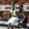 Oklahoma State\'s Le\'Bryan Nash (2) tries to get around Portland State\'s Renado Parker (30) during the college basketball game between Oklahoma State University and Portland State, Sunday,Nov. 25, 2012. Photo by Sarah Phipps, The Oklahoman