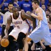 Photo - Oklahoma City's Kendrick Perkins (5) battles on the baseline with Denver's Danilo Gallinari (8) during the first round NBA playoff game between the Oklahoma City Thunder and the Denver Nuggets on Sunday, April 17, 2011, in Oklahoma City, Okla. Photo by Chris Landsberger, The Oklahoman