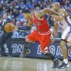 Chicago\'s Derrick Rose is fouled by Oklahoma City\'s Derek Fischer in the fourth quarter during their preseason game at the Intrust Bank Arena in Wichita, Ks., Wednesday, Oct. 23, 2013. Rose as the high scorer with 26 points as Chicago won 104-95. (AP Photo/The Wichita Eagle/Fernando Salazar)