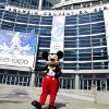 FILE - In this Sept. 9, 2009 handout photo released by Disney, Mickey Mouse stands in front of the Anaheim Convention Center in preparation for the Disney D23 Expo in Anaheim, Calif. The Walt Disney Co. is cracking open the vault, rolling out the red carpet and pulling back the curtain for more than 45,000 expected fans at this weekend\'s D23 Expo, Aug. 9-11, 2013, a three-event celebration of all things Disney at the Anaheim Convention Center. On the animation front, the studio will showcase Walt Disney Animation Studios\' computer-generated adventure