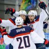 Photo - USA forward Zach Parise (9) celebrates his goal against the Czech Republic with teammates Phil Kessel (81) and USA defenseman Ryan Suter during the second period of men's quarterfinal hockey game in Shayba Arena at the 2014 Winter Olympics, Wednesday, Feb. 19, 2014, in Sochi, Russia. (AP Photo/Matt Slocum)