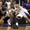 Sacramento Kings guard Marcus Thornton, foreground, battles for the ball with Portland Trail Blazers guard Ronnie Price during the first half of an NBA basketball game in Sacramento, Calif., Tuesday, Nov. 13, 2012. (AP Photo/Rich Pedroncelli)