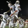 Photo - Auburn's Nick Marshall (14) congratulates Melvin Ray (82) after Ray's touchdown catch during the first half of the NCAA BCS National Championship college football game against Florida State Monday, Jan. 6, 2014, in Pasadena, Calif. (AP Photo/Chris Carlson)