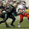 Oklahoma State\'s Austin Hays (84) tries to get past Baylor\'s Joe Williams (22) and Mike Hicks (17) in the first quarter during a college football game between the Oklahoma State University Cowboys (OSU) and the Baylor University Bears at Floyd Casey Stadium in Waco, Texas, Saturday, Dec. 1, 2012. Photo by Nate Billings, The Oklahoman