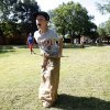 Logan McKee, 9, wins the potato sack races during a mother-son field day, Saturday, May 7, 2011, at Stephenson Park in Edmond, Okla.. Photo by Sarah Phipps, The Oklahoman