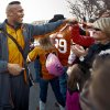 Defensive end Richetti Jones and other Cowboy players greet fans in the team\'s pre-game walk before the Bedlam college football game between the University of Oklahoma Sooners (OU) and the Oklahoma State University Cowboys (OSU) at Boone Pickens Stadium in Stillwater, Okla., Saturday, Nov. 27, 2010. Photo by Chris Landsberger, The Oklahoman