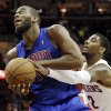 Cleveland Cavaliers\' Kyrie Irving (2) tries to strip the ball from Detroit Pistons\' Greg Monroe in the first quarter of an NBA basketball game on Wednesday, April 10, 2013, in Cleveland. (AP Photo/Mark Duncan)