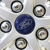 Photo -  This 2013 file photo shows a Ford emblem on a wheel of a sedan at a Ford dealership in Norwood, Mass. May Sales from the major automakers were reported Tuesday. AP Photo   Steven Senne -  AP