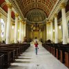 "Photo - A tourist walks in the Cathedral Basilica of the Immaculate Conception in Mobile, Ala., on Saturday, March 1, 2014. Mobile is that ""other"" city on the northern Gulf Coast, the one that sometimes gets lost between the beaches of the Florida Panhandle and New Orleans. The church is among the free attractions in Mobile. (AP Photo/Jay Reeves)"