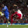 Photo - Manchester United's Wayne Rooney, right, attempts a bicycle kick past Chelsea's Ramires during their English Premier League soccer match at Old Trafford Stadium, Manchester, England, Monday Aug. 26, 2013. (AP Photo/Jon Super)