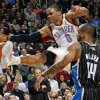 Oklahoma City\'s Russell Westbrook (0) has the ball knocked away as he is fouled by Orlando\'s Jameer Nelson (14) during the NBA basketball game between the Orlando Magic and Oklahoma City Thunder in Oklahoma City, Thursday, January 13, 2011. Oklahoma City won, 125-124. Photo by Nate Billings, The Oklahoman ORG XMIT: KOD